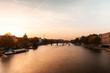 View of Pont des Arts bridge over Seine River at sunset, Paris, France