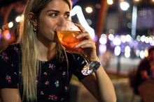 Close-up Of Young Woman Drinki...