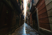 View Of Narrow Wet Alleyway In Gothic Quarter, Barcelona, Spain