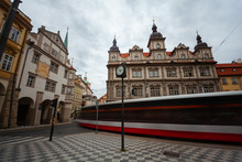 Blurred Motion Of Tram Passing Against Building In Old Town Square, Stare Mesto, Prague, Czech Republic