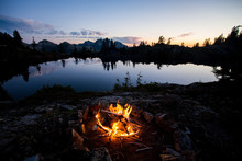 A Bonfire Beside A Lake In The...