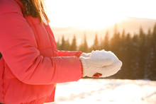 Woman Holding Pile Of Snow Out...