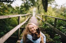 Girl Hug A Dog