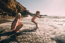 Siblings Enjoying Beach