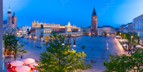 Fototapeta Aerial panorama of Medieval Main market square with Cloth Hall and Town Hall Tower in Old Town of Krakow at night, Poland obraz