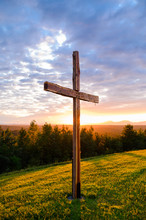 Faith Symbol Beautiful Wooden Cross On Hill With Sun Rays Behind In Nature Background Scene With Mountain Range And Colorful Sunset Sky