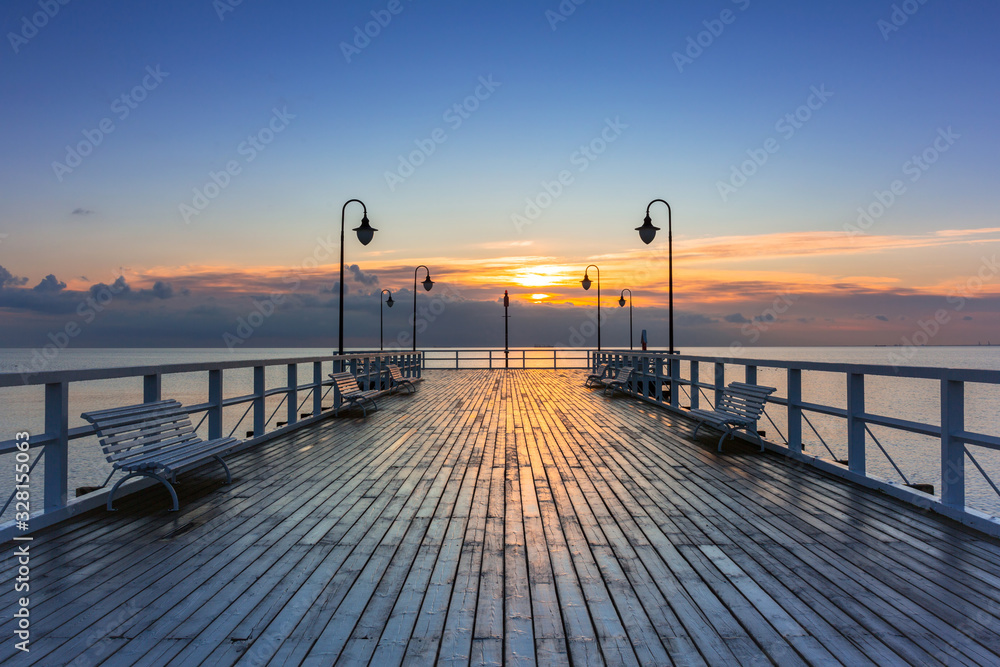 Fototapeta Beautiful landscape with wooden pier in Gdynia Orlowo at sunrise, Poland