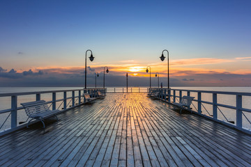 Beautiful landscape with wooden pier in Gdynia Orlowo at sunrise, Poland