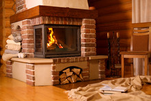 Fireplace With Burning Wood In...