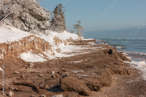 Slika na platnu Winter Beach Erosion along Lake Michigan in February 2020, with the high lake le