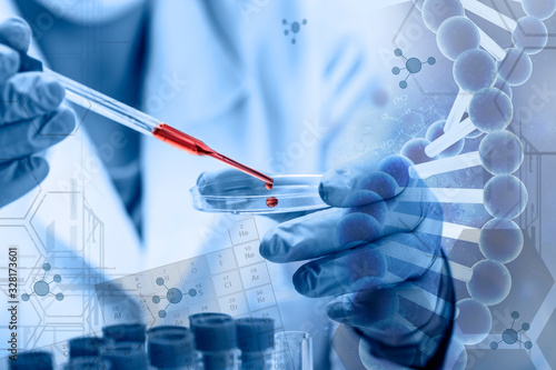 Science and medicine, scientist analyzing and dropping a sample into a glassware Canvas Print