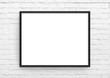 canvas print picture - Empty frame. Blank black landscape frame on white brick wall