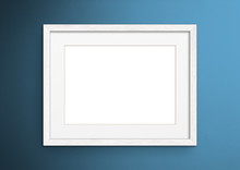 Empty Frame. Blank White Mounted Landscape Frame On Blue Wall