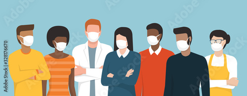 Group of people wearing surgical masks and standing together
