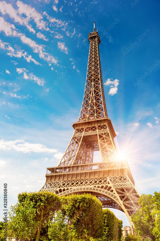 The Eiffel Tower in Paris on a beautiful sunny summer day at sunset