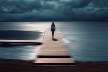 Woman Walks On Wooden Pier At ...