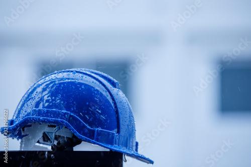 Raindrops on a construction helmet,heavy rain and construction safety helmets, blue hard safety helmet and raining
