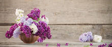 Lilac In Ceramic Vase On Old W...