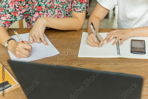 Fototapeta Business team work sitting at the table and writing on documents paperwork. obraz na płótnie