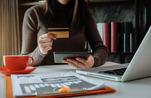 Hands Holding Credit Card And Using Laptop In Office Home. Online Shopping.