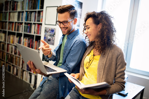 Group of college students studying in the school library. Canvas Print
