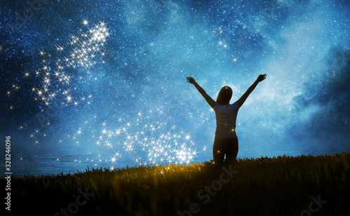Foto Girl watching the stars in night sky fantasy landscape