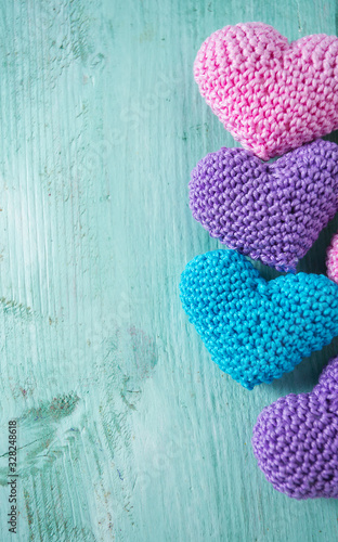 knitted hearts on turuoise wooden surface Canvas Print