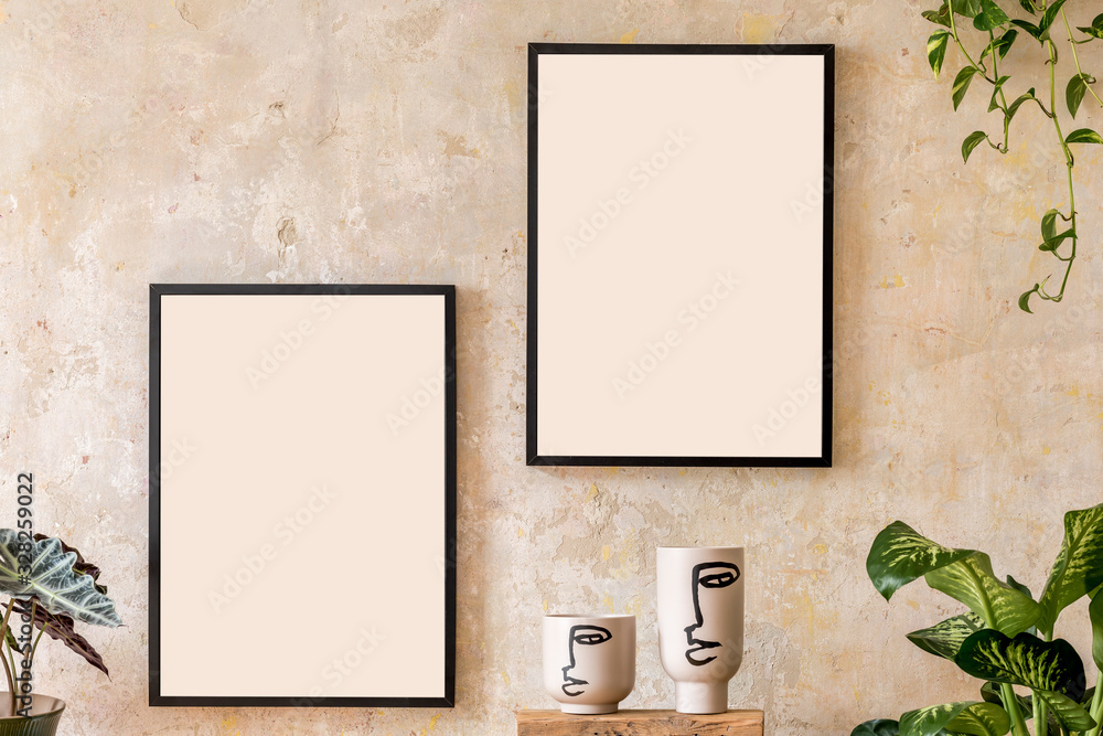 Fototapeta Interior design of living room with two black mock up poster frames, shelf, vases, plants and elegant personal accessoreis. Grunge wall. Stylish home decor. Wabi sabi concept.Template.
