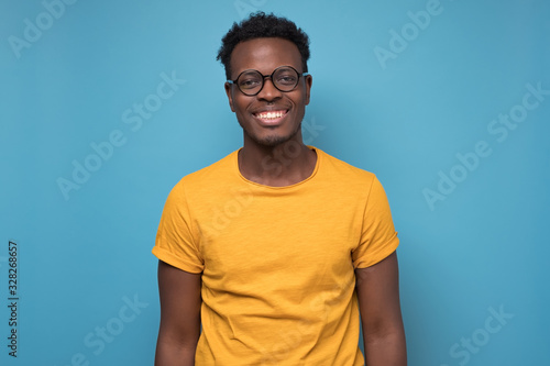 Obraz Black african american young man in yellow t-shirt with cheerful attitude - fototapety do salonu