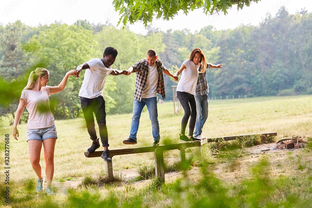 Fototapeta Group of young people exercises teamwork