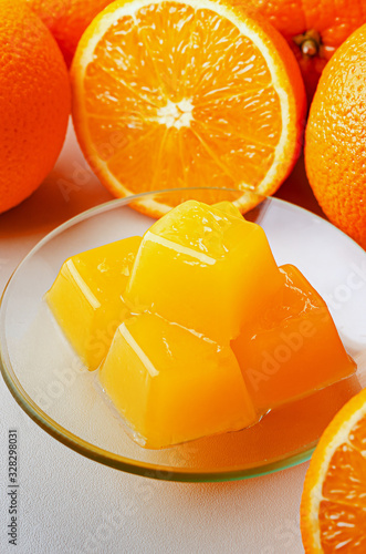 Photo Orange marmalade from agar agar. Healthy vegetarian sweets.