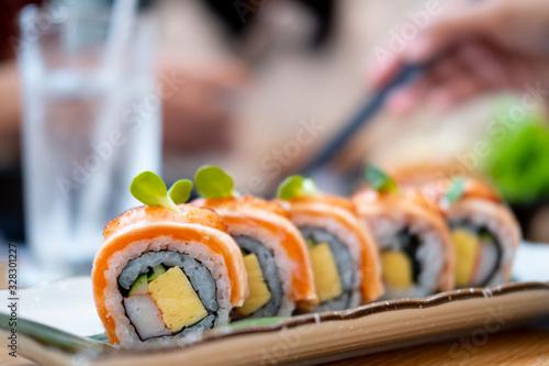 Fototapeta Close up and selective focus of salmon sushi roll maki obraz