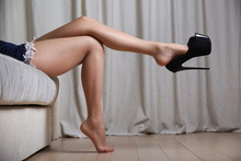 Female Leg In Pantyhose Dangli...