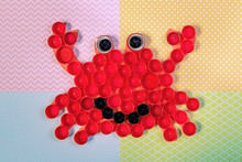 Crab Mosaic Decoration Made Of Colorful Plastic Bottle Caps . Summer Season And Ecology Concept. Handmade Kids Crafts. Recycling Art. Close Up