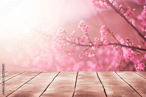 Fotografie, Obraz Spring seasonal of pink sakura branch with wooden table stand ,flower background