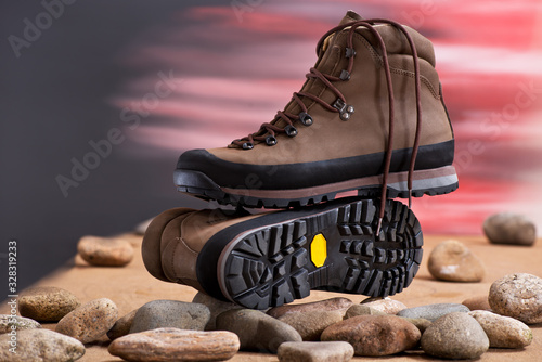 Pair of walking boots in the studio. Canvas Print