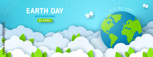 Obraz Earth Day banner or poster with paper cut clouds in blue sky. Background with green leaves, butterfly and globe. Vector illustration. Place for text. - fototapety do salonu
