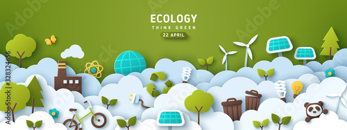Fototapeta Earth Day banner, background with clouds and ecology icons in paper cut style. Vector illustration. Light bulbs, trees, wind turbine and solar panels. Place for text. obraz