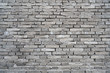 Rough dark gray building brick wall background