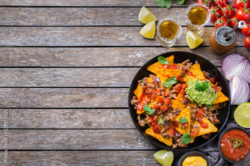 Chips nachos with beef, guacamole, chili, cheese salsa, tequila Wallpaper Mural