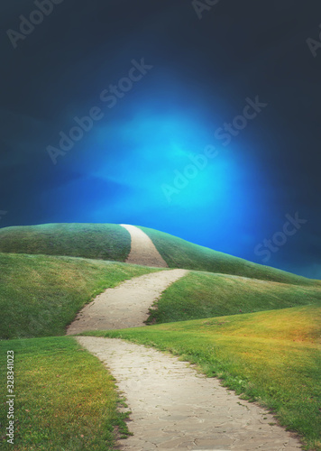 Fairy magic enchanted landscape with road, bright sky and green meadow