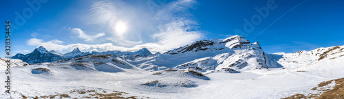 Wide parnoramic view of snow covered Swiss Alps in Grindelwald ski resort, Switz Wallpaper Mural