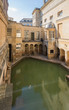 BATH, ENGLAND - March 27, 2019 - The Roman baths are Bath's major tourist attraction and receive more than 1.3 million tourists every year. The city of Bath is a UNESCO World Heritage Site.