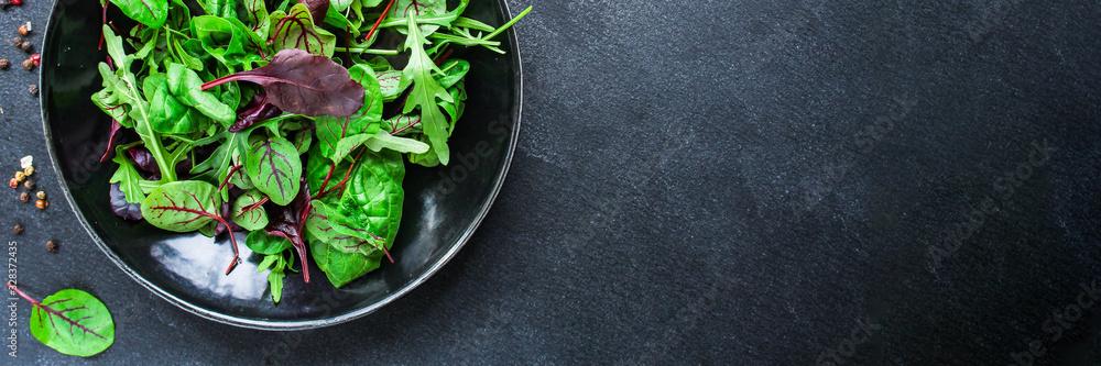 Fototapeta Healthy salad, leaves mix salad (mix micro greens, juicy snack) keto or paleo menu recipe. food background, copy space