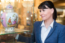 Woman Looking Vase From Her Co...