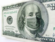 This photo illustration of Ben Franklin wearing a healthcare surgical mask on a one hundred dollar bill illustrates the Coronavirus, international travel, and economic costs