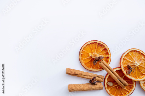 Fototapeta Dry oranges on white background with cinnamon and star anise.  Mulled wine set obraz
