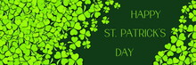 Pattern Of Green Clovers Or Shamrocks On Green Background. St. Patrick's Day Holiday Concept. Banner With Text Happy St. Patrick's Day.