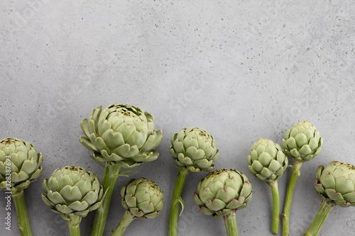 Fresh green artichokes on gray background Wallpaper Mural