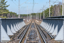 Railway Track On The Metal Bridge At Day Time.
